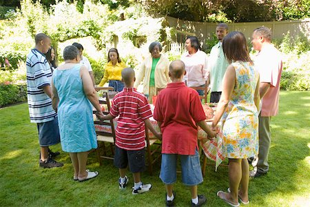 Family holding hands at picnic Stock Photo - Premium Royalty-Free, Code: 673-02139605