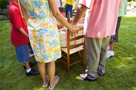 Family holding hands at picnic Stock Photo - Premium Royalty-Free, Code: 673-02139606
