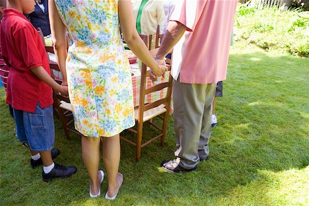 Family holding hands at picnic Stock Photo - Premium Royalty-Free, Code: 673-02139607
