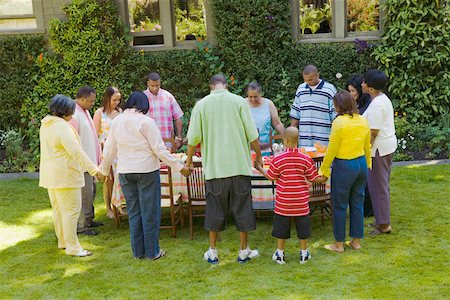 Family holding hands at picnic Stock Photo - Premium Royalty-Free, Code: 673-02139608