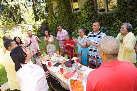 Enthusiastic family at picnic Stock Photo - Premium Royalty-Free, Code: 673-02139619