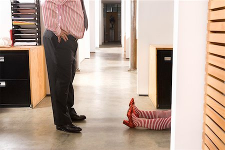 dead female body - Office worker discovering prone female body Stock Photo - Premium Royalty-Free, Code: 673-02139634