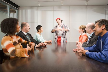 Weird co-worker at a meeting Stock Photo - Premium Royalty-Free, Code: 673-02139641