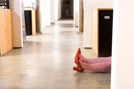 Body lying on office floor Stock Photo - Premium Royalty-Free, Code: 673-02139670