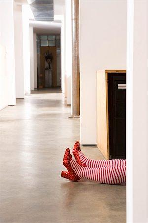 Body lying on office floor Stock Photo - Premium Royalty-Free, Code: 673-02139671