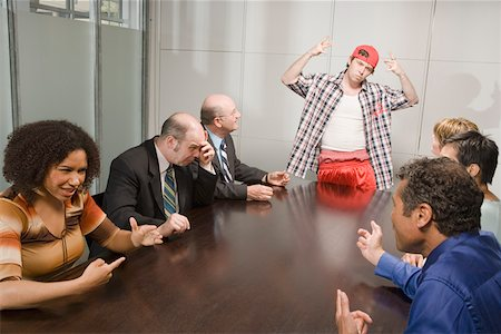 Weird co-worker at a meeting Stock Photo - Premium Royalty-Free, Code: 673-02139688