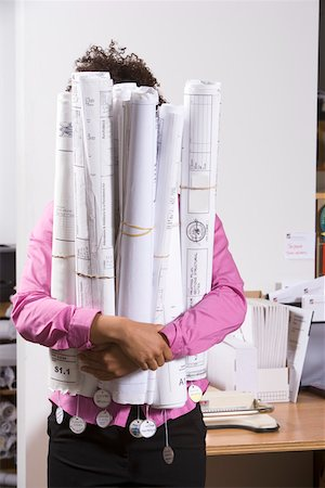 Woman holding bundle of blueprints Stock Photo - Premium Royalty-Free, Code: 673-02139708