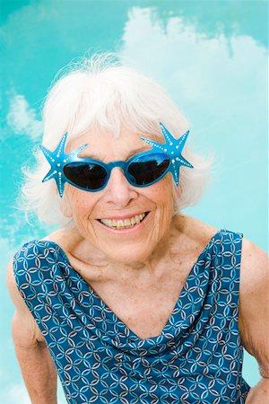 Woman wearing distinctive sunglasses Stock Photo - Premium Royalty-Free, Code: 673-02139795