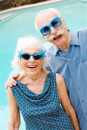 Senior couple in wacky sunglasses Stock Photo - Premium Royalty-Free, Code: 673-02139803