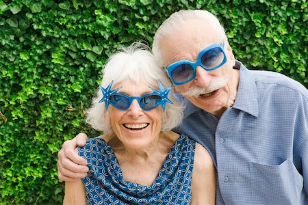 Senior couple in wacky sunglasses Stock Photo - Premium Royalty-Free, Code: 673-02139847