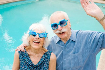 Senior couple in wacky sunglasses Stock Photo - Premium Royalty-Free, Code: 673-02139848