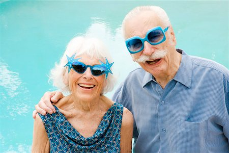 Senior couple in wacky sunglasses Stock Photo - Premium Royalty-Free, Code: 673-02139849