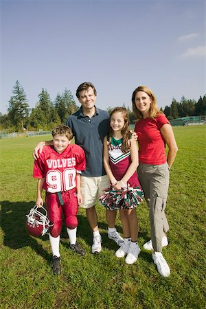 Football player and cheerleader with parents Stock Photo - Premium Royalty-Free, Code: 673-02139996