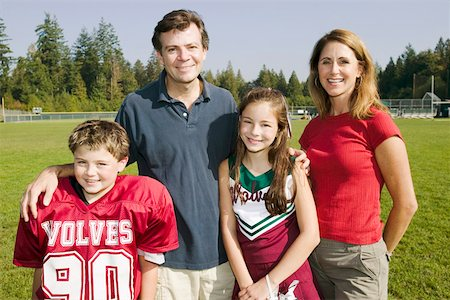 Football player and cheerleader with parents Stock Photo - Premium Royalty-Free, Code: 673-02139997
