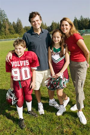Football player and cheerleader with parents Stock Photo - Premium Royalty-Free, Code: 673-02139998