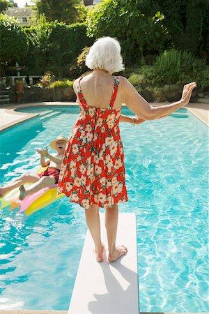 Senior couple having poolside fun Stock Photo - Premium Royalty-Free, Code: 673-02140197