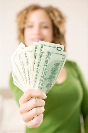 Closeup of woman's handful of money Stock Photo - Premium Royalty-Free, Code: 673-02140325