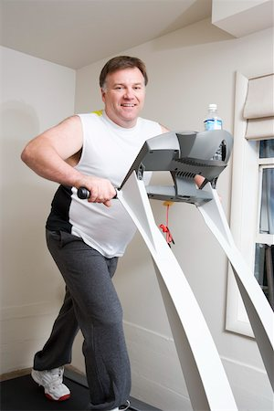 fat man exercising - Portrait of overweight man on treadmill Stock Photo - Premium Royalty-Free, Code: 673-02140416