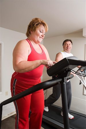 fat man exercising - Overweight couple using exercise machines Stock Photo - Premium Royalty-Free, Code: 673-02140417
