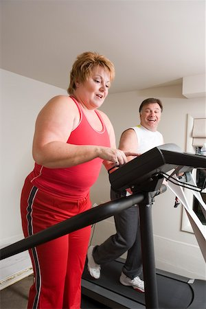 fat man exercising - Overweight couple using exercise machines Stock Photo - Premium Royalty-Free, Code: 673-02140418