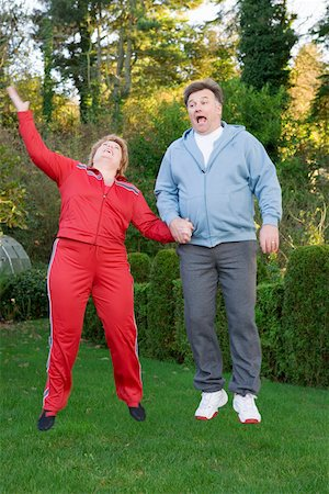fat man exercising - Middle aged couple jumping outdoors Stock Photo - Premium Royalty-Free, Code: 673-02140419