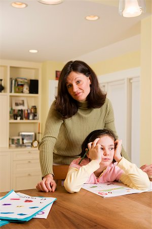 Mom with bored daughter doing homework Stock Photo - Premium Royalty-Free, Code: 673-02140757