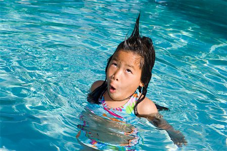 Closeup of girl in pool with silly hairdo Stock Photo - Premium Royalty-Free, Code: 673-02140937