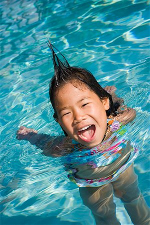 Closeup of girl in pool with silly hairdo Stock Photo - Premium Royalty-Free, Code: 673-02140939