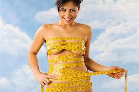 Portrait of nude woman wrapped in measuring tape Stock Photo - Premium Royalty-Free, Code: 673-02141127