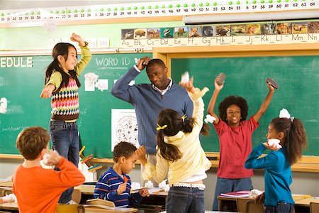 photo of class with misbehaving kids - Students having paper fight in classroom Stock Photo - Premium Royalty-Free, Code: 673-02141916