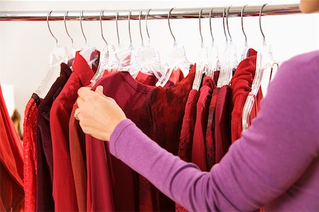Woman shopping at clothing store Stock Photo - Premium Royalty-Free, Code: 673-02141976
