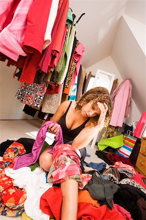 Woman looking for something to wear in closet Stock Photo - Premium Royalty-Free, Code: 673-02142014