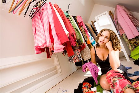 Woman looking for something to wear in closet Stock Photo - Premium Royalty-Free, Code: 673-02142015