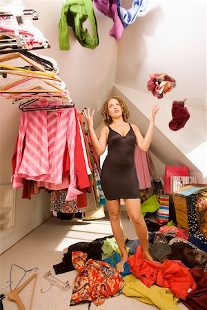 Woman looking for something to wear in closet Stock Photo - Premium Royalty-Free, Code: 673-02142013