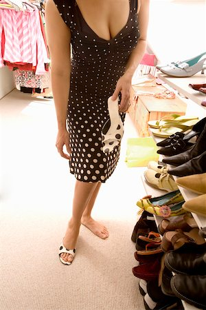 foot model - Woman deciding which shoes to wear Stock Photo - Premium Royalty-Free, Code: 673-02142024