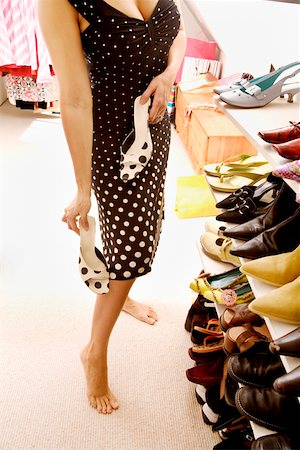 foot model - Woman deciding which shoes to wear Stock Photo - Premium Royalty-Free, Code: 673-02142022