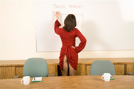 female rear end - Businesswoman writing on chart with dress pulled up Stock Photo - Premium Royalty-Free, Code: 673-02142264