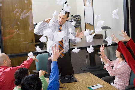 Businesspeople throwing paper at meeting Stock Photo - Premium Royalty-Free, Code: 673-02142279