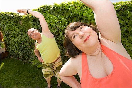fat man exercising - Couple stretching in backyard Stock Photo - Premium Royalty-Free, Code: 673-02142334