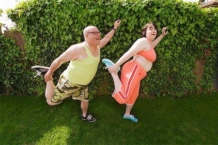 fat man exercising - Couple stretching in backyard Stock Photo - Premium Royalty-Free, Code: 673-02142335
