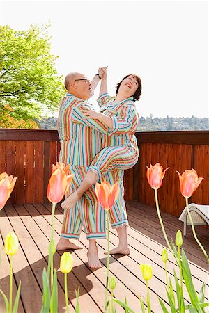 fat man exercising - Couple dancing on the patio in matching pajamas Stock Photo - Premium Royalty-Free, Code: 673-02142333