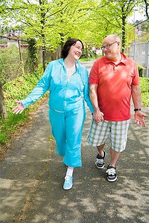 fat man exercising - Couple walking outside Stock Photo - Premium Royalty-Free, Code: 673-02142348