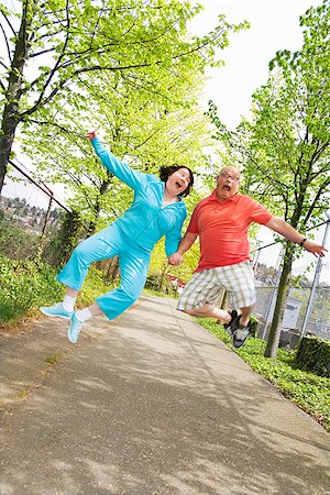 fat man exercising - Couple jumping outside Stock Photo - Premium Royalty-Free, Code: 673-02142341