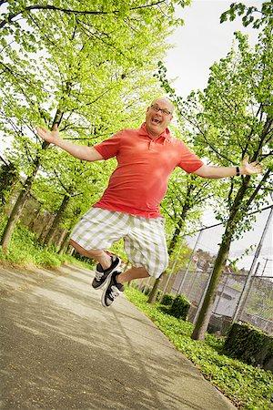 fat man exercising - Man kicking his heels together Stock Photo - Premium Royalty-Free, Code: 673-02142342