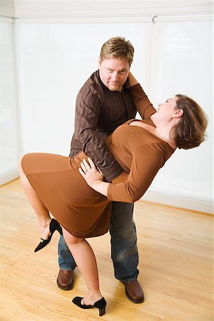 Couple dancing in living room Stock Photo - Premium Royalty-Free, Code: 673-02142444