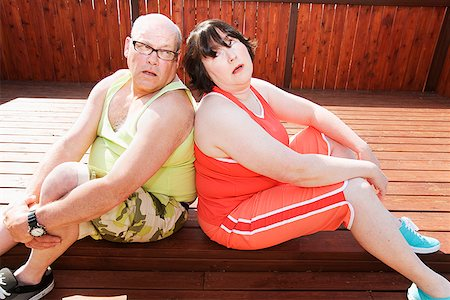Couple sitting together on patio Stock Photo - Premium Royalty-Free, Code: 673-02142466