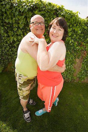 Couple hugging in backyard Stock Photo - Premium Royalty-Free, Code: 673-02142467