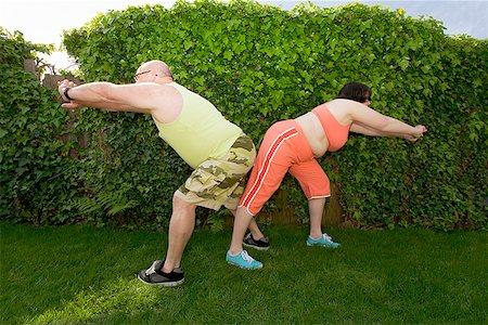 fat man exercising - Couple stretching in backyard Stock Photo - Premium Royalty-Free, Code: 673-02142461