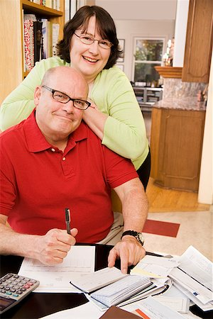 Couple paying bills Stock Photo - Premium Royalty-Free, Code: 673-02142499