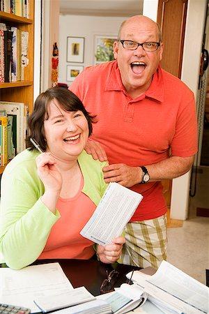 Couple paying bills Stock Photo - Premium Royalty-Free, Code: 673-02142518